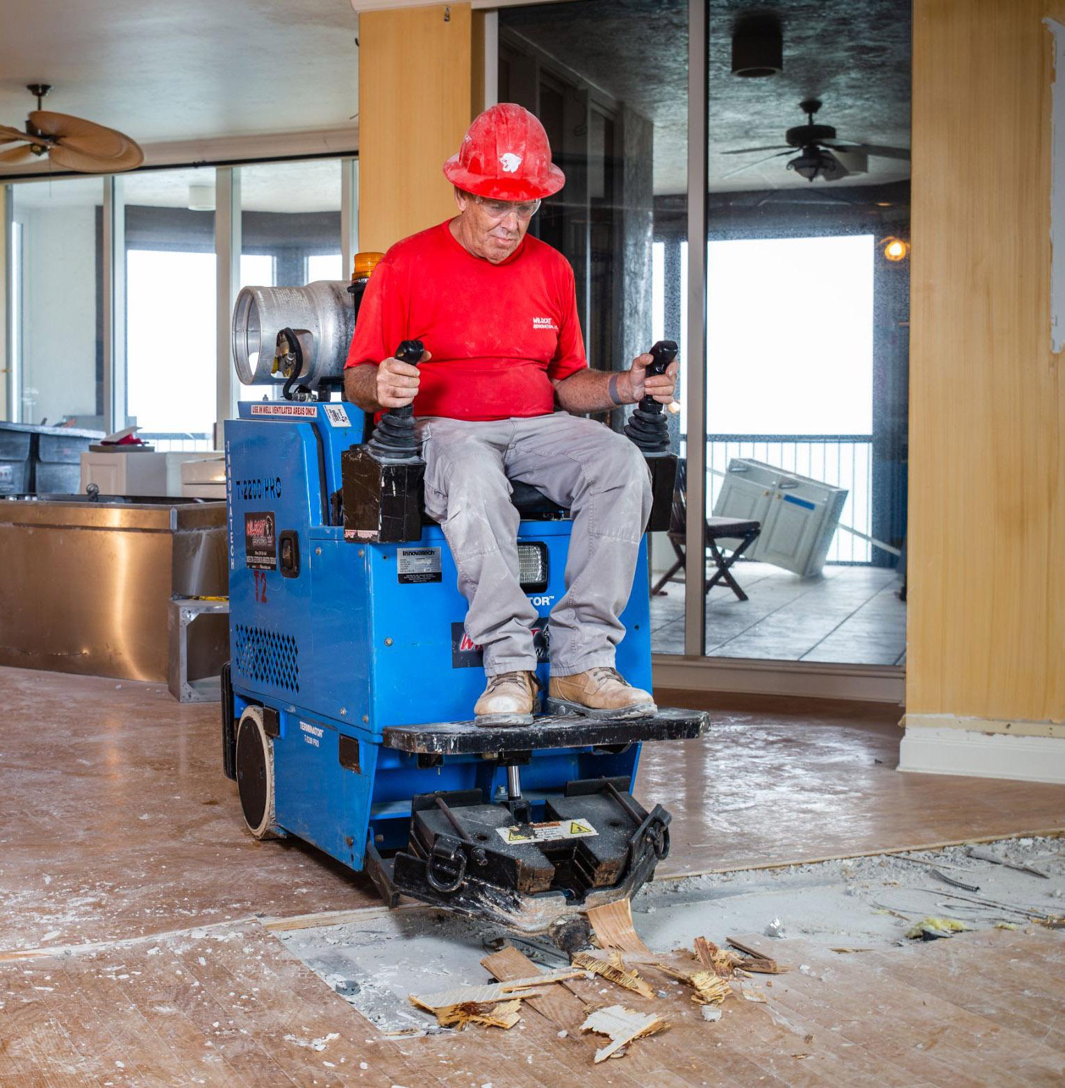 Wildcat Worker doing floor removal.