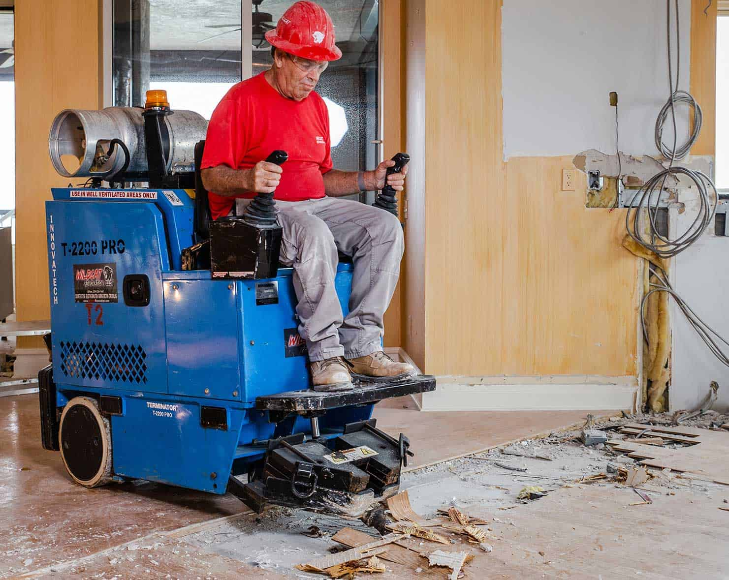Wildcat Employee doing flooring removal on removal machine