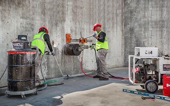 Wildcat Workers doing core drilling on concrete wall
