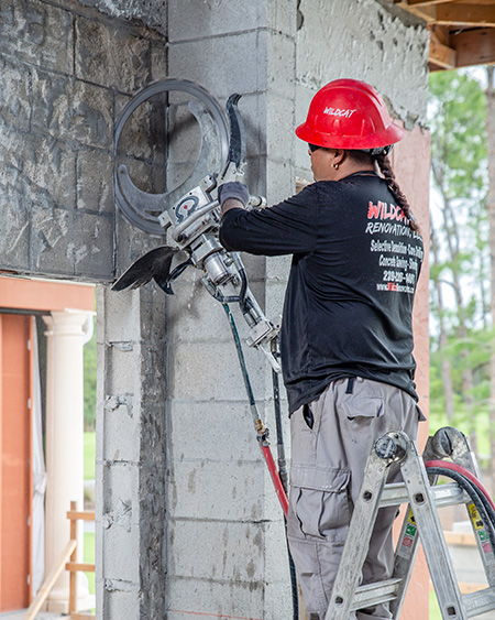 Wildcat Worker using diamond chain saw on wall