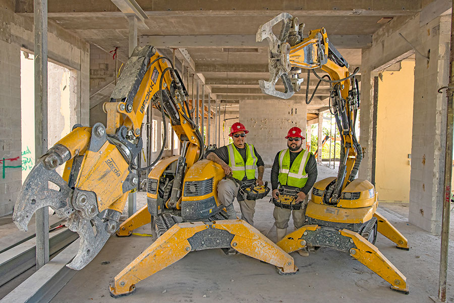 Brokk Operators standing next to Brokk170 and Brokk110